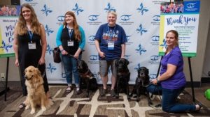 Four AFI 2019 Conference attendees with their guide dogs