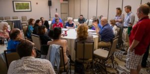 Attendees discuss topics at conference
